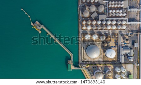 Aerial view of tank farm terminal with lots of oil storage tank and petrochemical storage tank in the harbour, Industrial tank storage aerial view.