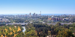 Aerial view of Tel-Aviv skyline with Yarkon River, road and sea