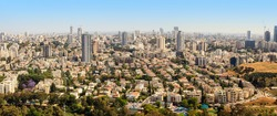Aerial view of Tel-Aviv urban skyline with skyscrapers on a sunny day