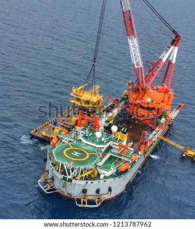 Aerial View of Tender Drilling Oil Rig (Barge Oil Rig) in The Middle of The Ocean or gulf, Offshore tender rig barge with crane and cable