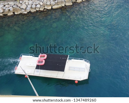 Aerial view of the a white tour boat waiting to take passengers on tours in a tropical island  #1347489260