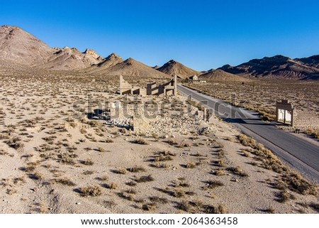 Aerial view of the abandoned ruins of Rhyolite mining camp in the Nevada desert. This Ghost town sits just outside the entrance to Death Valley National Park.