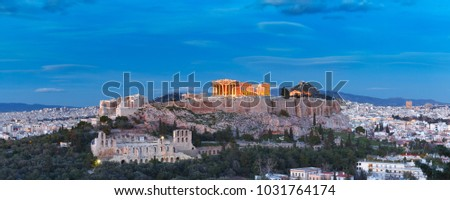 Aerial view of the Acropolis Hill, crowned with Parthenon, above of the city skyline during evening blue hour in Athens, Greece