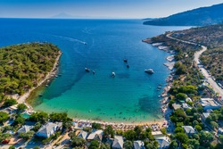 Aerial View of the Aliki Beach with colorful umbrellas, at Thassos island, Greece. swimming people in sea