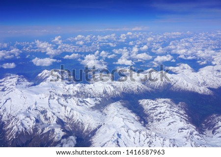 Aerial view of the Alps Mountains covered with snow over France and Switzerland #1416587963