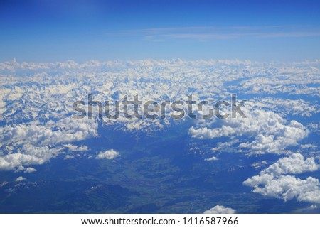 Aerial view of the Alps Mountains covered with snow over France and Switzerland #1416587966