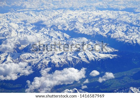 Aerial view of the Alps Mountains covered with snow over France and Switzerland #1416587969