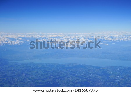 Aerial view of the Alps Mountains covered with snow over France and Switzerland #1416587975