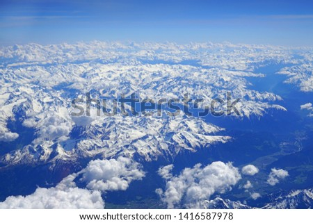 Aerial view of the Alps Mountains covered with snow over France and Switzerland #1416587978