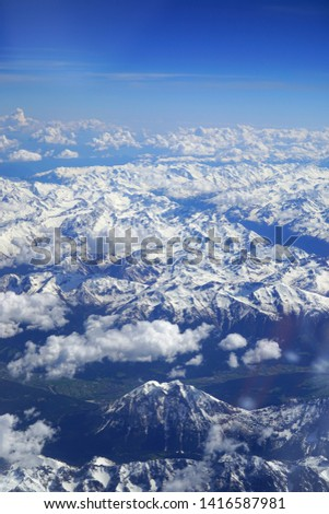 Aerial view of the Alps Mountains covered with snow over France and Switzerland #1416587981