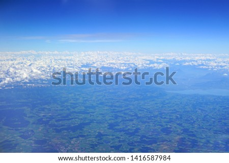Aerial view of the Alps Mountains covered with snow over France and Switzerland #1416587984