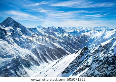 Aerial view of the Alps mountains in Switzerland. View from helicopter in Swiss Alps. Mountain tops in snow. Breathtaking view of Jungfraujoch and the UNESCO World Heritage - the Aletsch Glacier #505071232