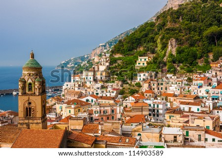 Aerial view of the Amalfi city with bell tower in front, Italy