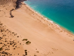Aerial view of the beach Playa de Las Conchas in the north of La Graciosa, the main archipelago island Chinijo, a mile northwest of Lanzarote. Canary island. Spain. Ocean view and sand beach
