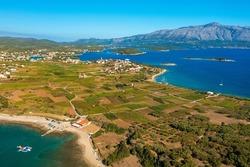 Aerial view of the beaches and fields near Lumbarda town on Korcula Island, Adriatic Sea in Croatia