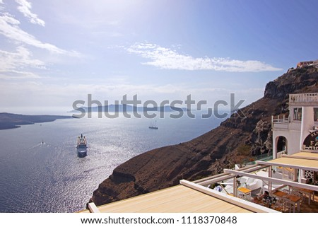 Aerial view of the beautiful Aegean sea with​ clear blue water, Santorini, Cycladic islands, Greece