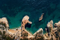 Aerial view of the beautiful Albandeira Beach (Praia da Albandeira) in Lagoa, Algarve, Portugal