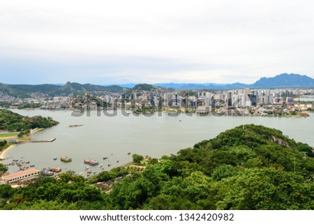 Aerial view of the beautiful city of Vitoria, Espirito Santo, Brazil and its wide bay. The city developed with its high buildings growing on the hills and into the local greenery