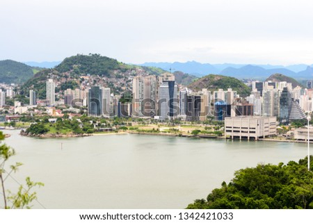 Aerial view of the beautiful city of Vitoria, Espirito Santo, Brazil and its wide bay. The city developed growing on the hills and into the local greenery