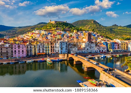 Aerial view of the beautiful village of Bosa with colored houses and a medieval castle. Bosa is located in the north-wesh of Sardinia, Italy. Aerial view of colorful houses in Bosa village, Sardegna. Stockfoto ©