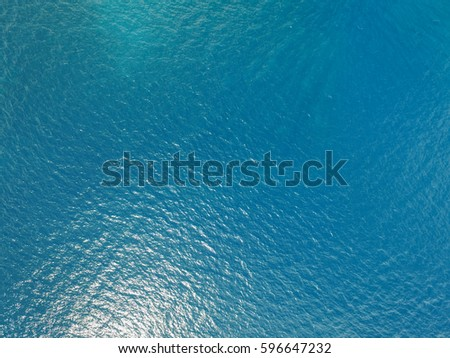 Aerial view of the blue ocean and sunlight reflection in the Caribbean #596647232