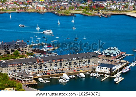 Aerial view of the Boston harbor and waterfront buildings. Colorful, bright image