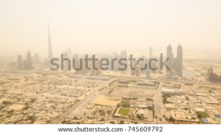 Aerial view of the business district of Dubai. Shooting in the summer haze of heat. August 2014. UAE. #745609792