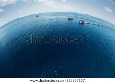 Aerial view of the calm tropical sea with ships on surface #232537537