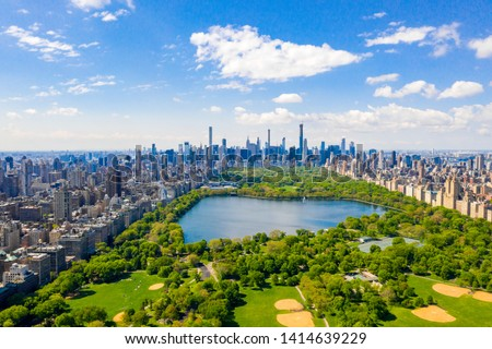 Aerial view of the Central park in New York with golf fields and tall skyscrapers surrounding the park. #1414639229