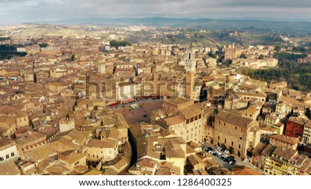 Aerial view of the city of Siena involving famous Piazza del Campo or Campo Square. Tuscany, Italy #1286400325