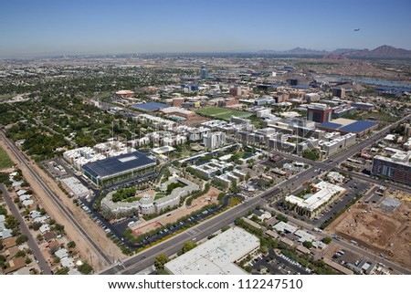 Aerial view of the City of Tempe with college campus skyline