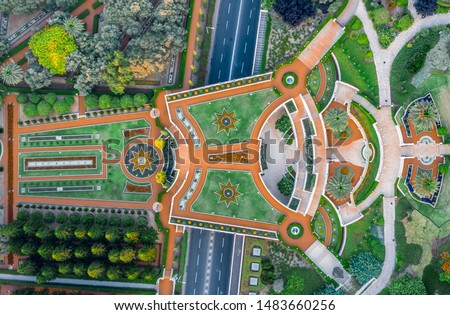 Aerial view of the colorful, magnificent Bahai garden on the hills of the Carmel in Haifa Israel, with orange and green geometric shapes