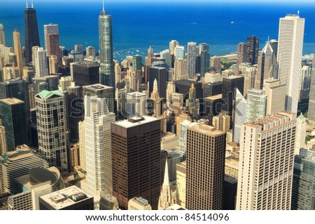 Aerial view of the core of downtown Chicago with Lake Michigan in the background.