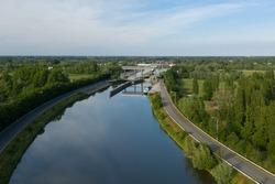 Aerial view of the Dender river and the Tijsluis locks, in Dendermonde, Belgium