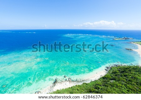 Aerial view of the deserted beach on the tropical island with vast coral reef and clear blue sea, Kume Island, Okinawa, Japan