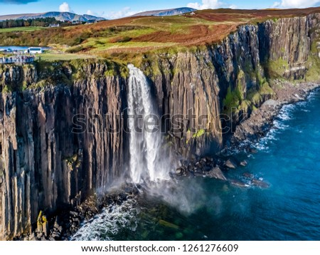 Aerial view of the dramatic coastline at the cliffs by Staffin with the famous Kilt Rock waterfall - Isle of Skye - Scotland. #1261276609