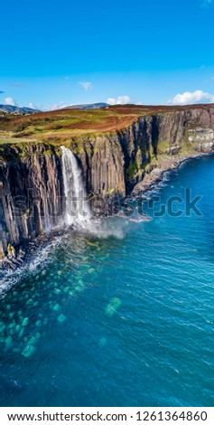 Aerial view of the dramatic coastline at the cliffs by Staffin with the famous Kilt Rock waterfall - Isle of Skye - Scotland. #1261364860