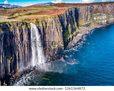 Aerial view of the dramatic coastline at the cliffs by Staffin with the famous Kilt Rock waterfall - Isle of Skye - Scotland. #1261364872