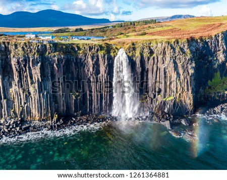 Aerial view of the dramatic coastline at the cliffs by Staffin with the famous Kilt Rock waterfall - Isle of Skye - Scotland. #1261364881