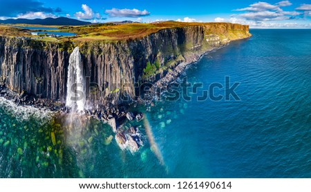 Aerial view of the dramatic coastline at the cliffs by Staffin with the famous Kilt Rock waterfall - Isle of Skye - Scotland. #1261490614