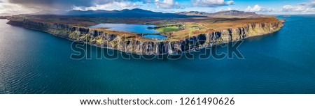 Aerial view of the dramatic coastline at the cliffs by Staffin with the famous Kilt Rock waterfall - Isle of Skye - Scotland. #1261490626