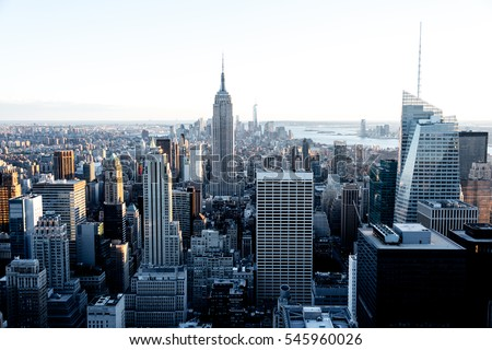 Aerial view of the Empire State Building and downtown Manhattan on a clear day at dusk, New York City.  #545960026