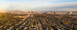 Aerial view of the entire length of Las Vegas Strip with surrounding homes and retail space