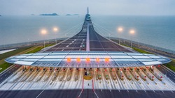 Aerial View Of The Entrance of Hong Kong-Zhuhai-Macao Bridge.  The Chinese words  means