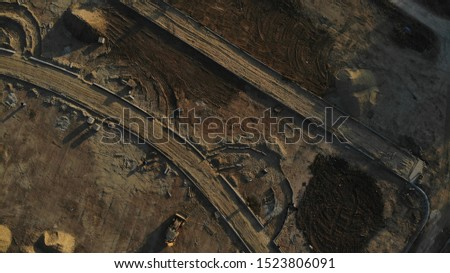 Aerial view of the excavator on the construction site. Construction site from the air.