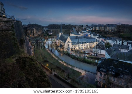 Aerial view of The Grund with Neumunster Abbey and Alzette River at night - Luxembourg City, Luxembourg Stock photo ©