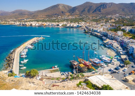 Aerial view of the harbor of the famous resort Chersonissos, Crete, Greece #1424634038