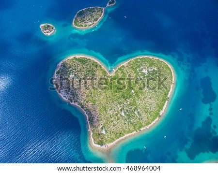 Aerial view of the heart shaped Galesnjak island on the adriatic coast.