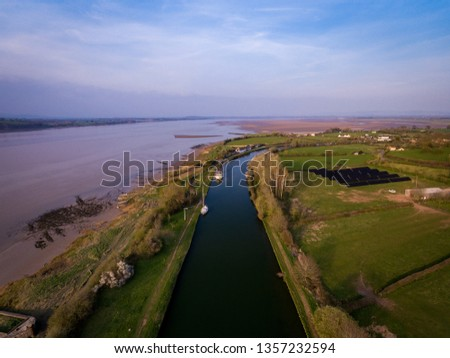 Aerial view of the Historic tidal river bank erosion protection scheme at Purton Hulks, Gloucestershire, UK #1357232594