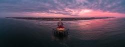 Aerial view of the Huntington Beach Pier in Huntington Beach, California at sunrise.